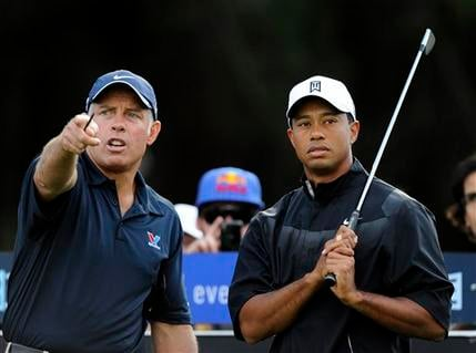 U.S. golfer Tiger Woods, right, looks on as his caddie Steve Williams gestures during the Australian Masters Pro-Am event at Victoria Golf Club in Melbourne, Australia, Wednesday, Nov. 10, 2010. (AP Photo/Andrew Brownbill)