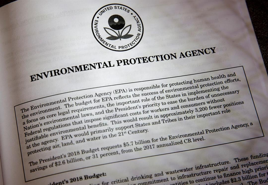 Proposals for the Environmental Protection Agency in President Donald Trump's first budget are displayed at the Government Printing Office in Washington, Thursday, March, 16, 2017. (AP Photo/J. Scott Applewhite)