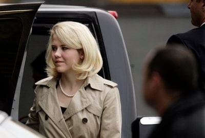 Elizabeth Smart is escorted into Frank Moss Federal Courthouse in Salt Lake City to testify in the Brian David Mitchell trial on Wednesday, Nov. 10, 2010, in Salt Lake City.