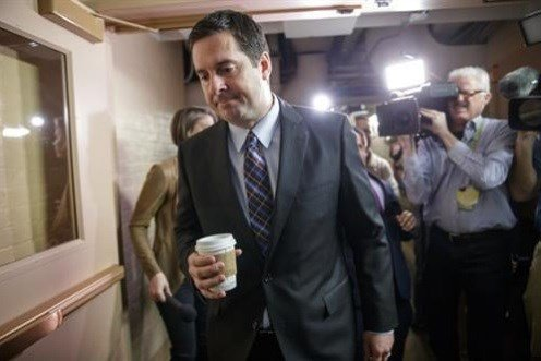 House Intelligence Committee Chairman Rep. Devin Nunes, R-Calif. is pursued by reporters.