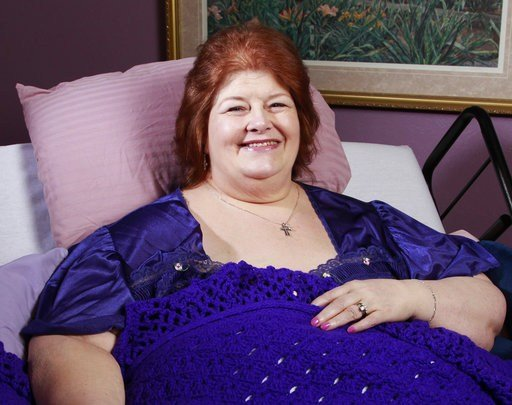 In this 2012 file photo, Darlene Cates, poses for picture at her home in Forney, Texas. (Michael Ainsworth/The Dallas Morning News via AP)