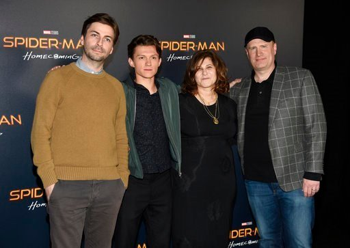 "Jon Watts, from left, director of ""Spider-Man: Homecoming,"" poses with, cast member Tom Holland and producers Amy Pascal and Kevin Feige during a photo call backstage."