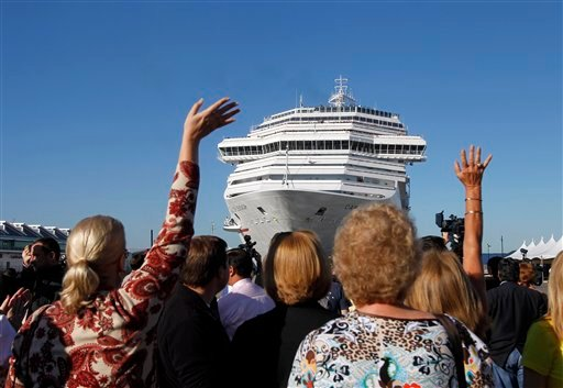 Spectators wave as the disabled Carnival Splendor cruise ship approaches the dock in San Diego on Thursday, Nov. 11, 2010. (AP Photo/Jae C. Hong)