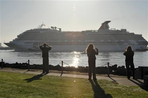 Spectators look on from shore as tugboats bring the disabled cruise ship Carnival Splendor into San Diego Bay on Thursday, Nov. 11, 2010.