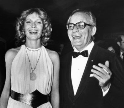 FILE - In this April 12, 1979 file photo, actress Mia Farrow, left, smiles with producer Dino De Laurentiis at the premiere of the movie 'Hurricane,'  in Los Angeles.