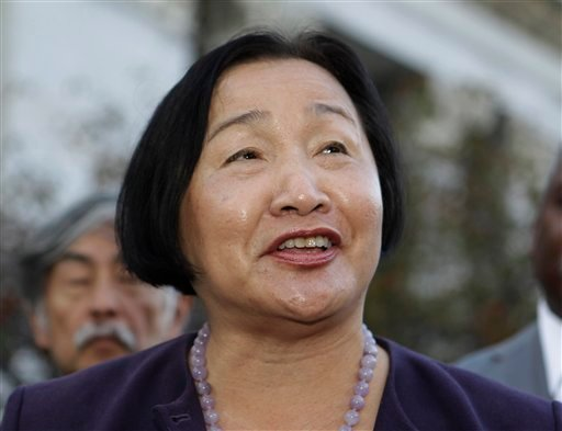 In this Nov. 8, 2010 file photo Oakland Councilwoman Jean Quan smiles during a news conference in front of Oakland City Hall in Oakland, Calif. (AP Photo/Paul Sakuma, File)
