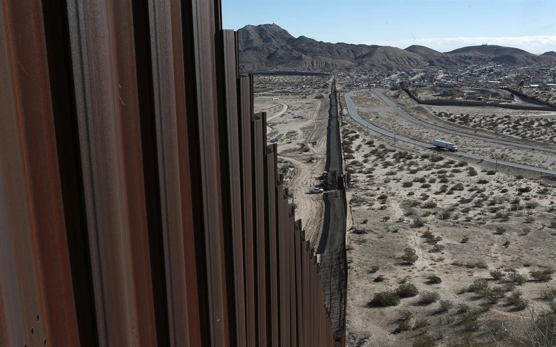 This file photo shows a truck driving near the Mexico-US border fence, on the Mexican side, separating the towns of Anapra, Mexico and Sunland Park, New Mexico. (AP Photo/Christian Torres, File)