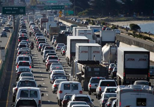 Traffic on westbound I-80 is reduced to a crawl in Berkeley, Calif., on Nov. 11, 2010 after a man stopped his car on the upper deck of the San Francisco-Oakland Bay Bridge threatening to kill himself. (AP Photo/San Francisco Chronicle, Paul Chinn)