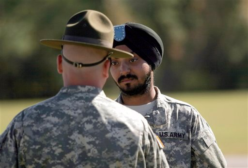 U.S. Army Spc. Simran Lamba, right, speaks to his drill sergeant following his graduation from basic combat training at Fort Jackson, S.C., Wednesday, Nov. 10, 2010.
