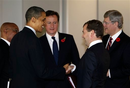 U.S. President Barack Obama, second left, smiles with other leaders, Britain's Prime Minister David Cameron, third left, Russia's President Dmitry Medvedev, second right, and Canada's Prime Minister Stephen Harper, right, at the G-20 working dinner.