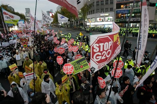 Protesters march along a street as the G20 Summit gets underway Thursday, Nov. 11, 2010 in Seoul, South Korea. Twenty world leaders are meeting in Seoul Nov. 11-12 to discuss the state of the global economy as it emerges from the financial crisis.