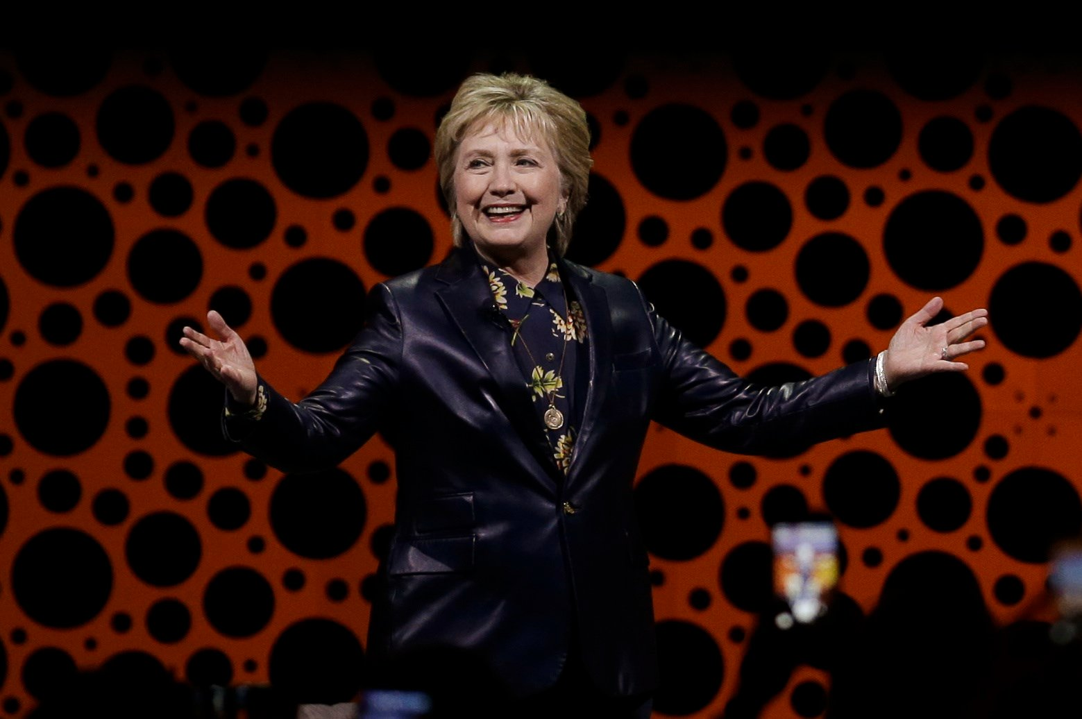 A spirited Hillary Clinton took on the Trump administration Tuesday in one of her first public speeches since she lost the presidential election, criticizing the country's Republican leaders on everything from health care to the shortage of women appointe