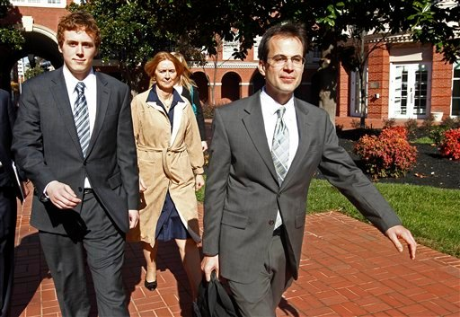 David Kernell, left, leaves the Federal Courthouse with his mother, Lt. Col. Lillian Landrigan, center, and attorney Wade Davies, right Friday, Nov. 12, 2010 in Knoxville, Tenn.