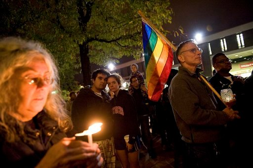 In this Oct. 3, 2010 file photo, people participate in a candlelight vigil for Rutgers University freshman Tyler Clementi at Brower Commons on the Rutgers campus in New Brunswick, N.J. (AP Photo/Reena Rose Sibayan, File)