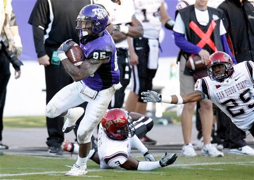 TCU reciever Jeremy Kerley (85) runs past San Diego State defensive backs Darryn Lewis (3) and Larry Parker (29) for a touchdown during the first half of an NCAA college football game in Fort Worth, Texas, on Saturday, Nov. 13, 2010. (AP Photo)