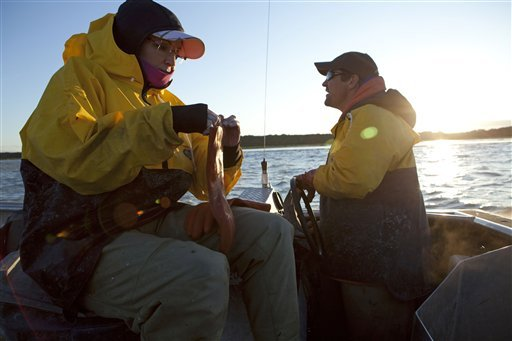 Sarah Palin, left, and her husband Todd Palin fish near Todd's parents house in Dillingham, Alaska as part of a documentary for the TLC channel. (AP Photo/Discovery Communications, Gilles Mingasson