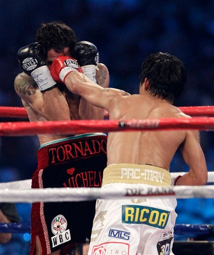 Manny Pacquiao, right, lands a left against Antonio Margarito during the second round of their WBC light middleweight title boxing match Saturday, Nov. 13, 2010, in Arlington, Texas. (AP Photo/LM Otero)