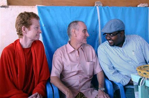 British sailors Paul and Rachel Chandler, left, talk with a local leader after the two were released from captivity on Sunday, Nov. 14, 2010 in Adado town, Somalia. (AP Photo)