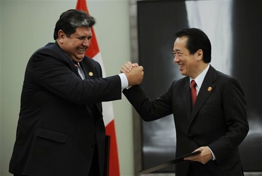 Peruvian President Alan Garcia, left, and Japanese Prime Minister Naoto Kan grip hands each other after signing an agreement during their bilateral meeting held on the sidelines of the APEC leaders' summ in Yokohama, Japan, Sunday, Nov. 14. (AP Photo)