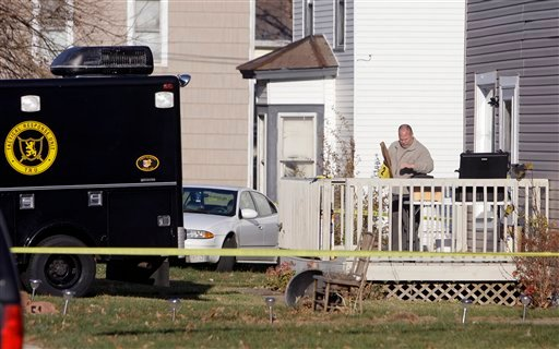 An investigator from the Bureau of Criminal Identification and Investigation processes evidence at the residence of 30-year-old Matthew Hoffman . (AP)