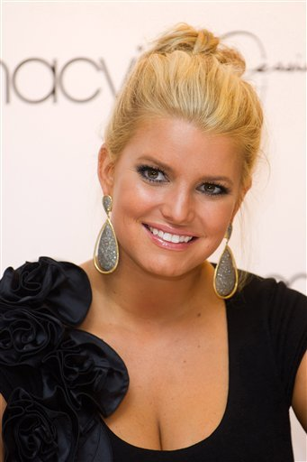 "FILE -- In a Sept. 15, 2010 file photo Jessica Simpson appears at the launch of Macy's ""Find Your Magic"" campaign in New York. Jessica Simpson representatives Lauren Auslander and Cindi Berger tell The Associated Press."