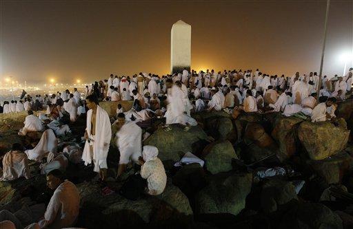 Muslim pilgrims pray on a rocky hill called the Mountain of Mercy, on the Plain of Arafat near Mecca, Saudi Arabia, Monday, Nov. 15, 2010. The annual Islamic pilgrimage draws 2,5 million visitors each year. (AP)