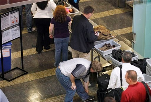 U.S. officials are defending new anti-terrorism security procedures at the nation's airports that some travelers complain are overly invasive and intimate. (AP Photo/Manuel Balce Ceneta)