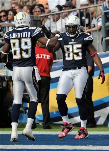 San Diego Chargers tight end Antonio Gates, right, reacts with wide receiver Seyi Ajirotutu after Gates scored against the New England Patriots in the second half during an NFL football game Sunday, Oct. 24, 2010, in San Diego.