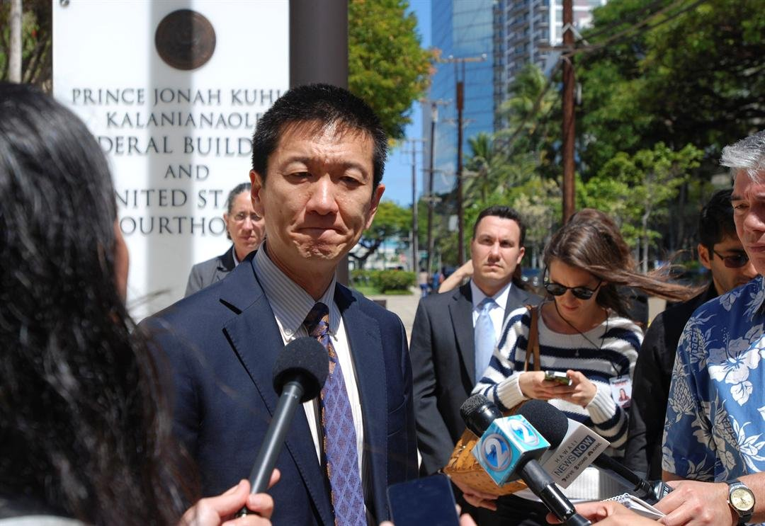 Hawaii Attorney General Douglas Chin speaks outside federal court in Honolulu, Wednesday, March 29, 2017. (AP Photo/Caleb Jones)