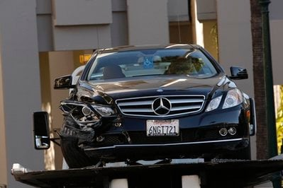 A damaged Mercedes E350 in which a woman, well-known Hollywood publicist Ronni Chasen, 64, was shot several times in the chest and killed, sits on a towtruck Tuesday, Nov 16, 2010 in Beverly Hills, Calif.