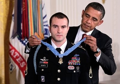 President Barack Obama presents the Medal of Honor to Staff Sgt. Salvatore Giunta, who rescued two members of his squad in October 2007 while fighting in the war in Afghanistan, Tuesday, Nov. 16, 2010, at the White House in Washington.