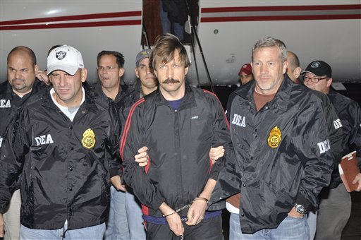 This image provided by the Drug Enforcement Administration shows Russian arms trafficking suspect Viktor Bout, center, in U.S. custody after being flown from Bangkok to New York on Tuesday Nov. 16, 2010 .