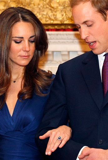 Britain's Prince William and his fiancee Kate Middleton pose for the media at St. James's Palace in London, Tuesday Nov. 16, 2010, after they announced their engagement. The couple are to wed in 2011. (AP Photo/Kirsty Wigglesworth)
