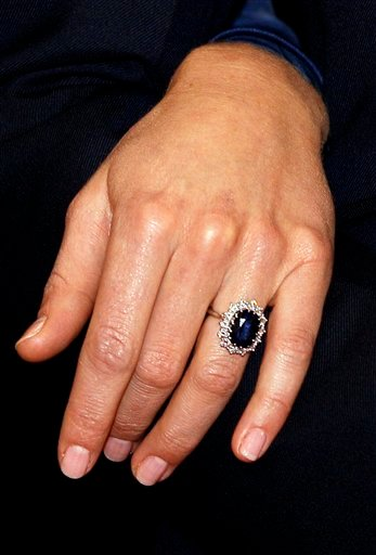 Kate Middleton wears the engagement ring of Diana, Princess of Wales, as she poses for the media with Britain's Prince William following the announcement of their engagement, at St. James's Palace in London, Tuesday Nov. 16, 2010.