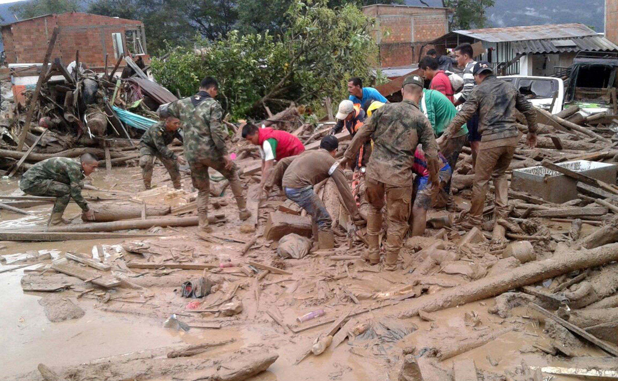 The incident triggered by intense rains left at least 100 people dead in Mocoa, located near Colombia's border with Ecuador. (Colombian Army Photo via AP)