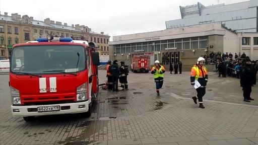 In this image taken from video footage, emergency services work outside Sennaya Square metro station in St Petersburg, Russia, Monday, April 3, 2017. (AP Photo)