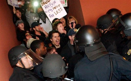 Protesters break the line of University of California police officers at the garage entrance to the University of California Campus in San Francisco, Calif. on Wednesday Nov. 17, 2010. (AP Photo/The Oakland Tribune, Laura A. Oda)