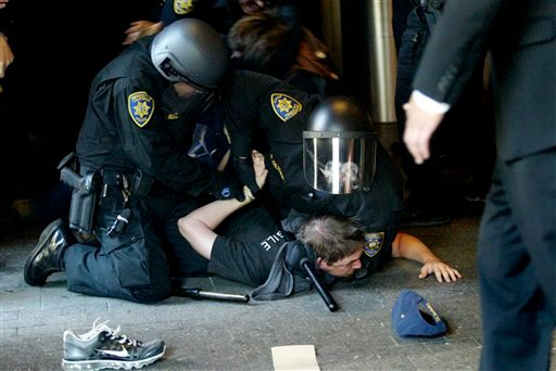 Students clashed with police outside a meeting of the UC Board of Regents at the entrance to the University of California Campus in San Francisco, Calif. on Wednesday Nov. 17, 2010. (AP Photo/The Oakland Tribune, Laura A. Oda)