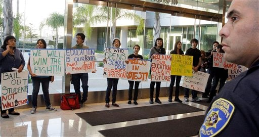 Students against hikes in student fees or tuition stage a protest in the lobby outside a meeting of the trustees of the California State University, at CSUC headquarters in Long Beach, Calif., Nov. 9, 2010. (AP Photo/Reed Saxon)