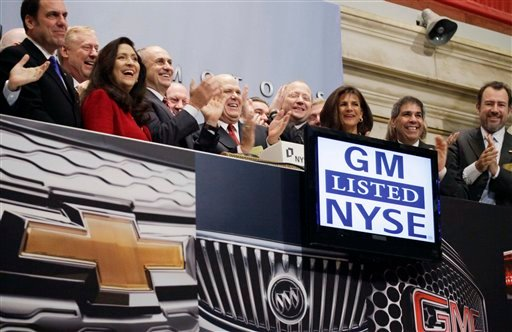 GM CEO Daniel Akerson, center with red tie, and GM employees attend the opening bell ceremony at the New York Stock Exchange prior to the GM initial public offering, Thursday, Nov. 18, 2010 in New York. (AP Photo/Mark Lennihan)