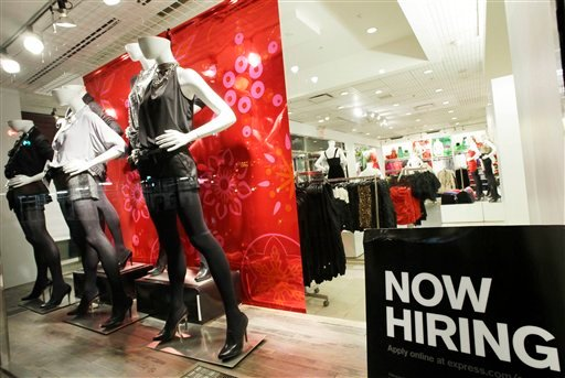 "A ""now hiring"" sign is shown in the window of an Express clothing store, in New York. Slightly more people applied for unemployment benefits last week, but first-time claims remain near their lowest level in 2 years. (AP Photo/Mark Lennihan)"