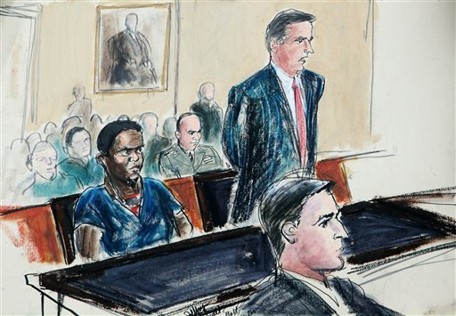 June 9, 2009 file courtroom sketch: Guantanamo detainee Ahmed Khalfan Ghailani, left, listens as his civilian lawyer Scott Fenstermaker, right, speaks at his arraignment in U.S. Federal Court in New York. (AP Photo/File)(AP Photo/Elizabeth Williams, File)
