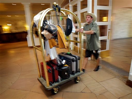In this photo taken on Oct. 14, 2010, David Dumyahn, a bell hop of at the Farimont-Scottsdale Princess Resort in Scottsdale, Ariz brings in luggage for guests.