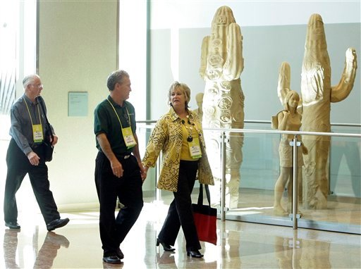 Attendees for the National School Supply and Equipment Association convention arrive at the Phoenix Convention Center, Thursday, Nov. 18, 2010, in Phoenix, Ariz.