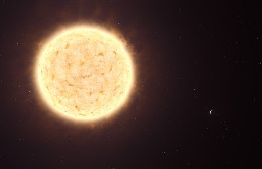 This artist's rendering provided by the European Southern Observatory shows a planet, appearing as a crescent at the lower-right of its parent star, HIP 13044, left. (AP Photo/European Southern Observatory, L. Calçada)