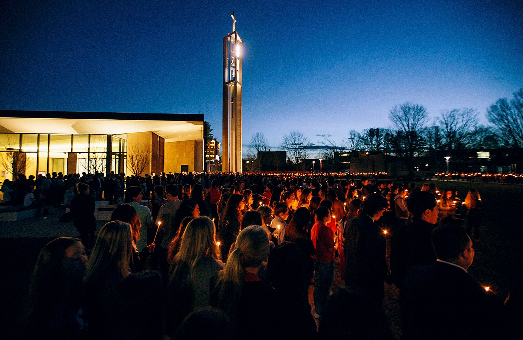 In this April 2, 2017 photo released by Sacred Heart University, students participate in a candlelight vigil in memory of student Caitlin Nelson on the school's campus in Fairfield, Conn. (Sean Kaschak/Sacred Heart University via AP)