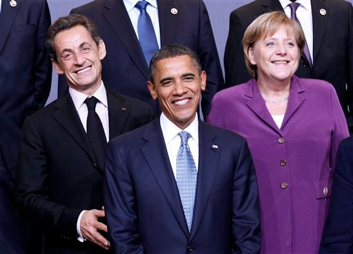 President Barack Obama, flanked by French President Nicolas Sarkozy, left, and German Chancellor Angela Merkel, are seen during the NATO Official group photo. (AP Photo/Pablo Martinez Monsivais)