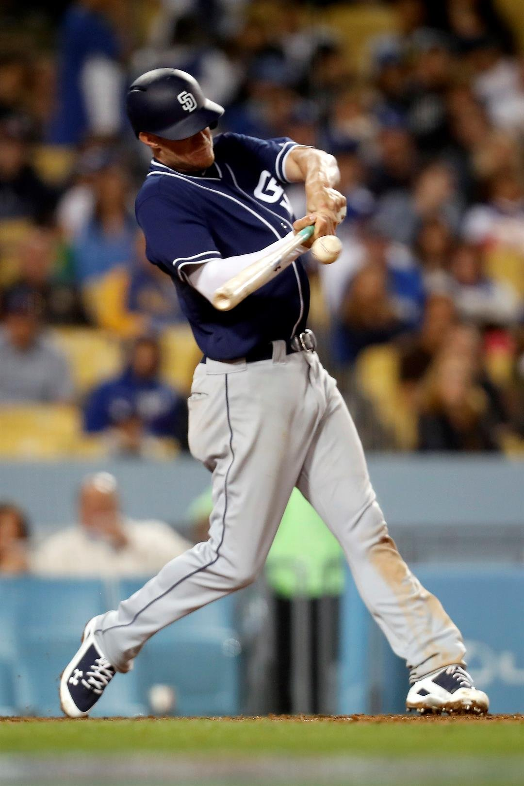 San Diego Padres' Wil Myers hits an RBI single against the Los Angeles Dodgers during the eighth inning of a baseball game, Tuesday, April 4, 2017, in Los Angeles. (AP Photo/Ryan Kang)