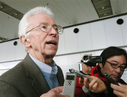 In this Nov. 13, 2010, photo, American nuclear scientist Siegfried Hecker, left, speaks to media upon returning from North Korea, at Beijing international airport in Beijing, China. (AP Photo/Kyodo News)