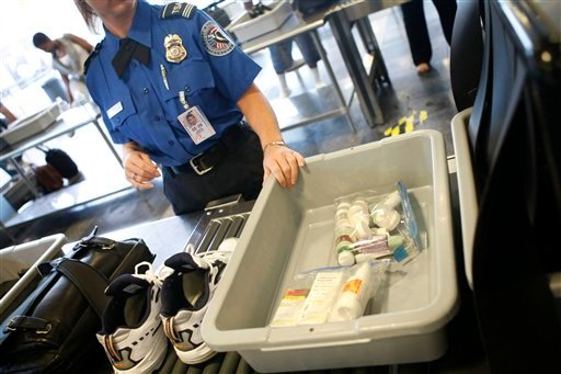 In this June 27, 2008 file photo, shoes and small liquid containers are placed in bins to be screened by TSA Supervisor Jennifer Haslip at the x-ray machine at Washington's Ronald Reagan National Airport. (AP Photo/Pablo Martinez Monsivais, File)